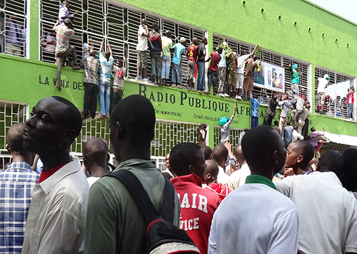 Supporters of Radio Publique Africaine director Bob Rugurika crowd around the station's offices to celebrate his release on bail last month. Rugurika's release comes as Burundi debates an easing of press laws. (AFP/Esdras Ndikumana)