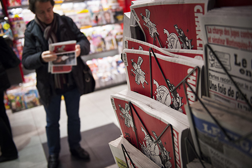 Satirical magazine Charlie Hebdo continues to be published after the deadly attack on its staff, but the show of solidarity for freedom of expression is subsiding. (AFP/Martin Bureau)