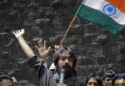 Aseem Trivedi speaks to the media after his arrest in 2012. Charges against the cartoonist have been dropped after India overturned part of its Information Technology Act. (Reuters/Danish Siddiqui)
