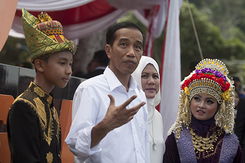 President Joko Widodo, pictured second left in Aceh province in March. Before he was elected in 2014, Widodo said he would allow international journalists access to Papua. (AFP/Chaideer Mahyuddin)
