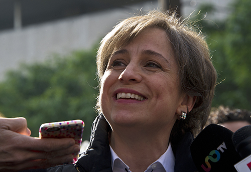 Carmen Aristegui speaks to the press outside MVS Radio in Mexico City on March 16. The investigative journalist was dismissed after demanding that the station reinstate two reporters it fired last week. (AFP/Ronaldo Schemidt)