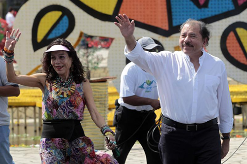 Nicaragua's President Daniel Ortega with his wife, Rosario Murillo, at a memorial for Venezuelan President Hugo Chávez in 2014. Independent journalists say Murillo controls press access to Ortega. (Reuters/Oswaldo Rivas)
