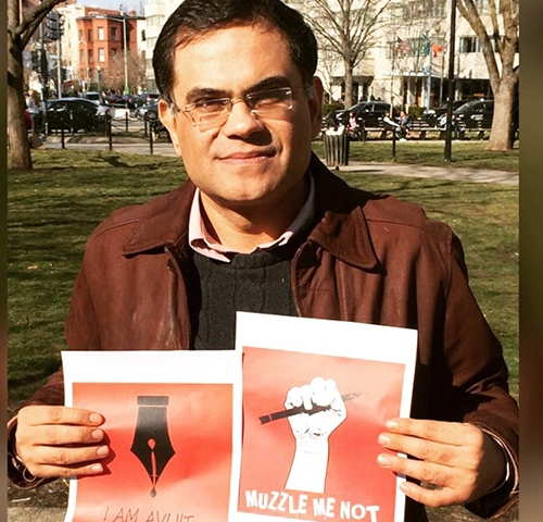 Raza Rumi, pictured in Washington, D.C. in March at a rally for a murdered Bangladeshi blogger, has been living in the U.S. since gunman attacked him last year. (Raza Rumi)