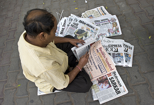 Indian papers announce the election victory of Narendra Modi in May 2014. Journalists say reporting on government issues has become challenging in the past year. (AFP/Prakash Singh)