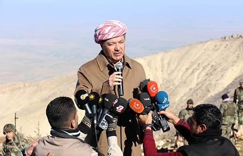 Iraqi Kurdish leader Masoud Barzani speaks to journalists at Mount Sinjar, west of Mosul, in December 2014 as fighters take on the Islamic State. The militant group kidnapped several journalists when it took over Mosul. (AFP/Safin Hamed)