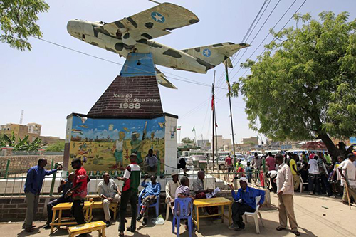 Residents sit under Somaliland's Independence memorial in Hargeisa. Journalists there say conditions are improving, but they remain wary. (Reuters/Feisal Omar)