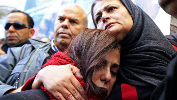 The mother, right, of photographer Nadhir Ktari, who disappeared with fellow journalist Sofiane Chourabi in Libya in September 2014, attends a demonstration held in solidarity with the missing pair, in Tunis on January 9, 2015. (Reuters/Anis Mili)
