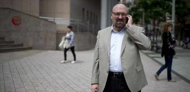 Mario Costeja Gonzalez speaks on his mobile phone outside a court in Barakaldo, Spain, on June 25, 2013. As a result of a lawsuit he filed against Google, Internet companies can be made to remove irrelevant or excessive personal information from search engine results, Europe's top court ruled.  (Reuters/Vincent West)