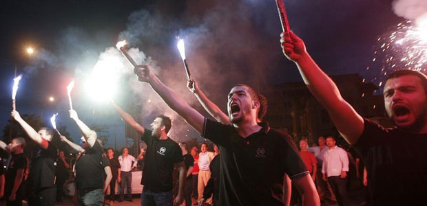 Supporters of the extreme-right Golden Dawn party raise flares as they celebrate polls results in Thessaloniki, Greece, on May 6, 2012. (Reuters/Grigoris Siamidis)