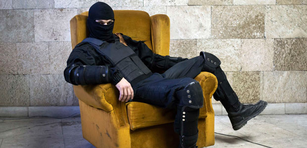 A masked pro-Russian protester poses for a photo inside a regional government building overtaken by his group in Donetsk, Ukraine, on April 25, 2014. (Reuters/Marko Djurica)
