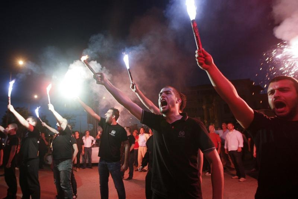Supporters of the extreme-right Golden Dawn party raise flares as they celebrate polls results in Thessaloniki, Greece, on May 6, 2012