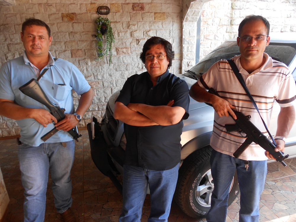 Cándido Figueredo, veteran border-beat reporter for Paraguay's largest newspaper, travels with armed bodyguards on the rare occasions that he leaves the safety of his home. (John Otis)