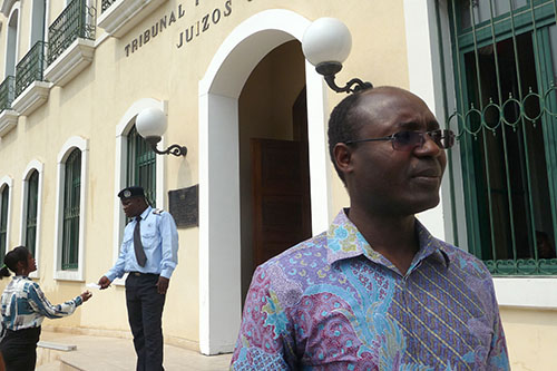 Rafael Marques de Morais outside a Luanda court on May 25. Criminal defamation charges have been reinstated against the investigative journalist just days after they were dropped. (AFP/Estelle Maussion)