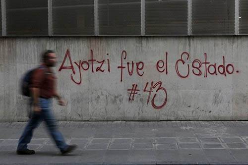 Graffiti referring to 43 students who went missing last September is spray painted on a wall in Mexico City as part of protests about their disappearance. Some journalists say they have struggled to cover the case. (Reuters/Tomas Bravo)