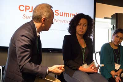 Jacob Weisberg, chairman of The Slate Group and a member of CPJ's board, left, speaks with BuzzFeed's Miriam Elder, center, and Global Voices' Sahar Habib Ghazi, right, about securing the newsroom. (CPJ/Geoffrey King)