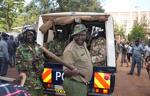 Police help protect protest organizers from a mob attack in the western Kenyan town of Kitale. (David Sirengo)