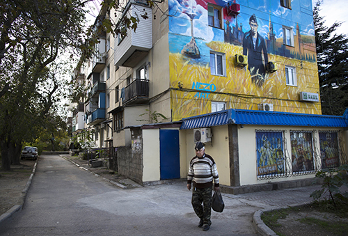 A mural in Sevastopol shows President Vladimir Putin in a Navy uniform. Crimea's press is struggling to survive after Russia illegally annexed the Ukrainian region. (AP/Alexander Zemlianichenko)