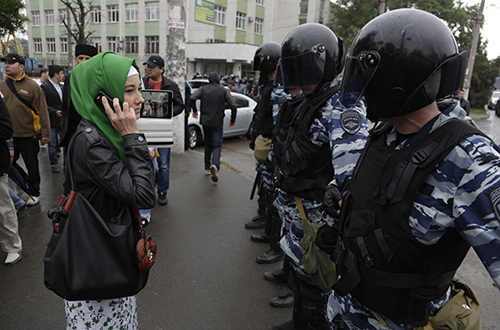 Russian riot police block a road in Simferopol as Crimean Tatars gather for a rally. The ethnic minority's main broadcaster has been forced off air since annexation. (AP/Max Vetrov)
