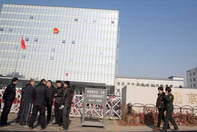 Police gather near Beijing No. 3 People's Intermediate Court where veteran journalist Gao Yu is on trial on accusations of leaking state secrets, Friday, November 21, 2014. (AP/Ng Han Guan)