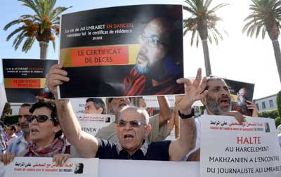 Moroccans take part in a demonstration to support French-Moroccan satirical journalist Ali Lmrabet on July 24 in front of the parliament in the Moroccan capital Rabat. (AFP/Fadel Senna)