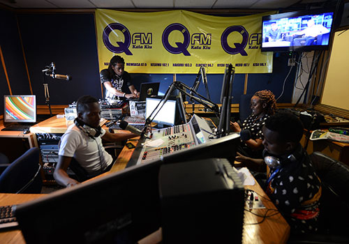 Q radio presenters during a broadcast in March 2015. The station is owned by Nation Media Group, one of the 'big five' privately owned Kenyan news outlets. (AFP/Simon Maina)