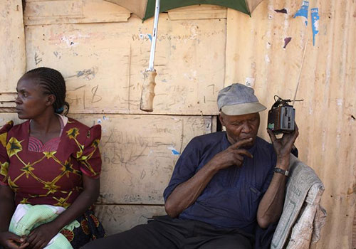 A Kenyan listens to the latest election results on a radio in 2013. More than 115 stations broadcast across the country. (Reuters/Siegfried Modola)