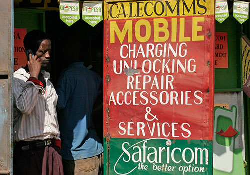 A cell phone shop in the Kibera slum in Nairobi. Despite the country's advances in technology Kenyans do not have greater access to objective news. (AP/Khalil Senosi)