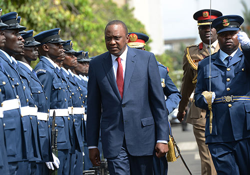 President Uhuru Kenyatta arrives at parliament in March 2015. His rule has been described as hostile to press freedom, local journalists say. (AFP/Simon Maina)