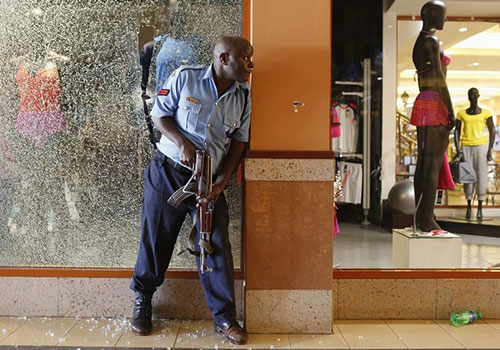 A police officer responds to a mass shooting in Nairobi's Westgate Shopping Center in September 2013. In the aftermath of the shooting, the government is trying to restrict reporting on terror attacks. (Reuters/Siegfried Modola)
