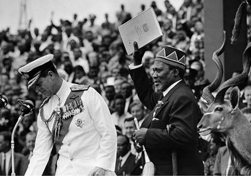 Jomo Kenyatta celebrates Kenya's newly found independence with Prince Philip at a ceremony in December 1963. Land grants issued by Kenyatta after independence continue to be a sensitive issue. (AFP)