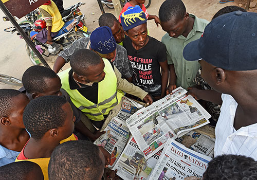 Local papers report on the Garissa college massacre in April. Under proposed media laws, journalists may face fines for showing victims of attacks without police permission. (AFP/Carl de Souza)