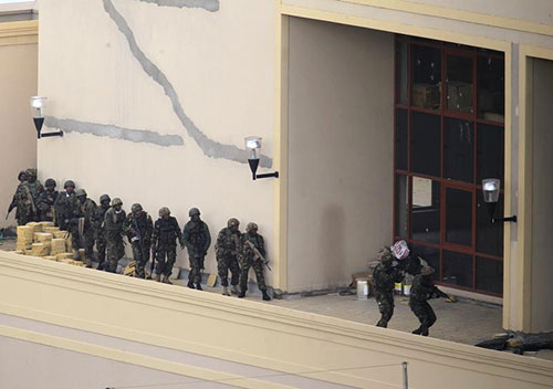 Kenyan soldiers search the roof of Westgate Shopping Center after gunmen open fire on shoppers. The government has moved to restrict reporting on terror attacks. (Reuters/Noor Khamis)