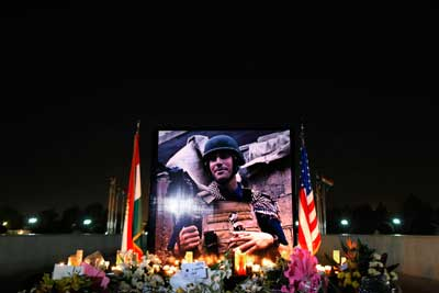 A photograph of James Foley is seen during a memorial service in Erbil in Iraqi Kurdistan on August 24, 2014. (AP/Marko Drobnjakovic)