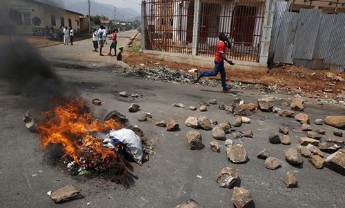 A Bujumbura road is blocked during unrest over elections in Burundi in July. Many Burundians, including journalists, have gone into exile to flee the violence. (Reuters/Mike Hutchings)