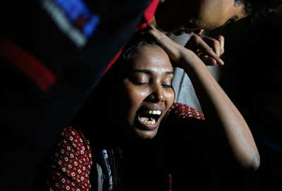 Ashamoni, wife of blogger Niloy Neel, cries at her house in Dhaka Friday. (AP/A.M. Ahad)