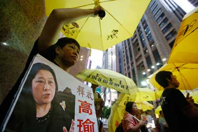 Anti-Beijing protesters in Hong Kong demand the release of jailed journalist Gao Yu on July 23. (AP/Kin Cheung)