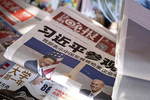 Newspapers in Beijing report on the president's visit to the U.S. News of protests in th U.S. about China's human rights record are absent from China's press. (AP Photo/Mark Schiefelbein)