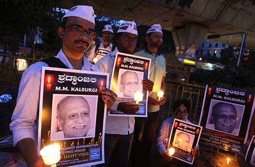 A vigil for rationalist scholar M.M. Kalburgi, who was shot dead earlier this year. Threats against writers and journalists from the rationalist school of thought are rising in India. (AP/Aijaz Rahi)