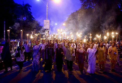 Bangladeshi protesters hold torches in a demonstration against the murder of Niloy Neel, the fourth blogger killed in the country this year. (AFP/Munir uz Zaman)