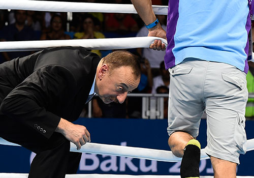 Azerbaijani President Ilham Aliyev enters a boxing ring at the first European Games in Baku in 2015. Despite Azerbaijan jailing journalists and human rights activists, the EU is pursuing a close relationship with the country. (AFP/Tobias Schwarz)