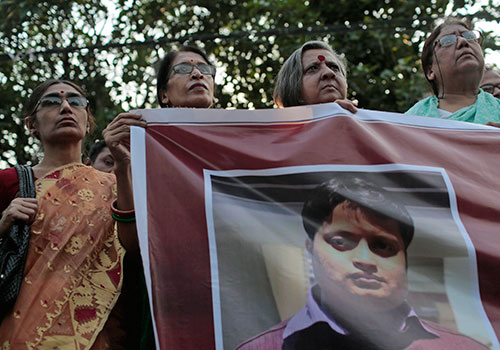 A banner showing murdered Bangladeshi blogger Ananta Bijoy Das is held up. Das was denied a visa to Sweden days before he was killed. (AP/A.M. Ahad)