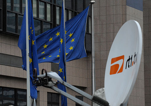 A broadcast truck outside EU headquarters in Brussels. Newspaper publishers say they are wary of EU directives that may influence media regulation. (AFP/John Thys)
