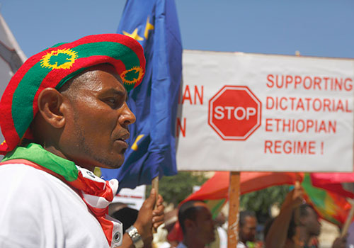 Ethiopian migrants living in Malta protest outside the prime minister's office, calling on the European Union to stop supporting the Ethiopian government. (Reuters/Darrin Zammit Lupi)