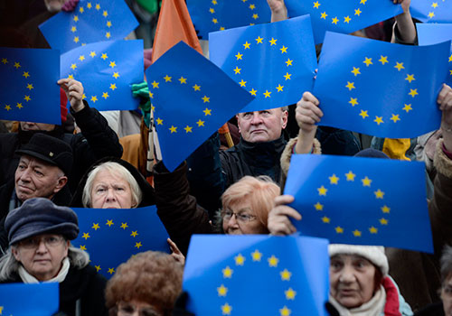 EU flags are held up in Budapest during a rally calling on the EU to help rein in Hungary's government. (AP/Tamas Kovacs)