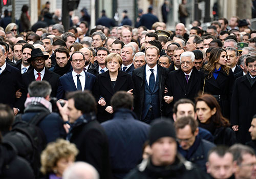 Leaders of member states join a solidarity march in Paris for the Charlie Hebdo victims. Several EU countries made calls for repressive legislation and greater surveillance in the months after the attack. (APF/Eric Feferberg)