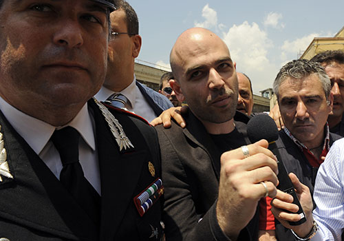 Roberto Saviano, author of Gomorrah, arrives for a court hearing. The Italian writer has been under police protection since 2006 because of threats from a Naples crime syndicate.  (AFP/Francesco Pischetola)