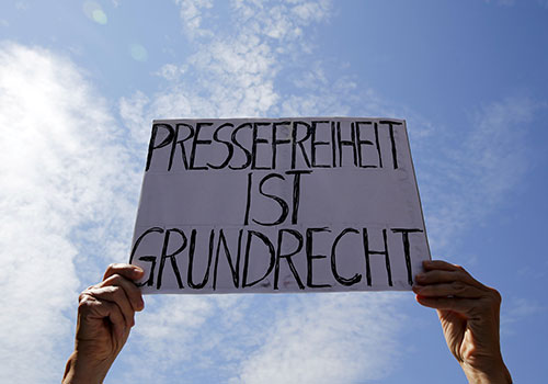 A sign reads 'Press freedom is a fundamental right' at a Berlin protest in support of Netzpolitik.org, which was accused of disclosing a state secret. Germany suspended the investigation. (Reuters/Fabrizio Bensch)