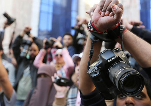 Supporters of imprisoned photojournalist Shawkan protest in Egypt. The EU has condemned the imprisonment of journalists in Egypt while acknowledging the country's regional importance. (Reuters/Mohamed Abd El Ghany)