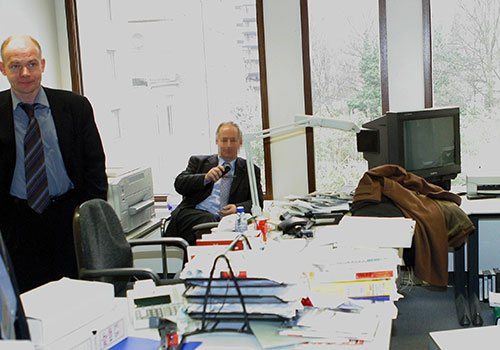 Hans-Martin Tillack, of Stern magazine, pictured left during a raid on his office by Belgian police after reporting on allegations made by a whistleblower. (AFP/Tierry Monasse)