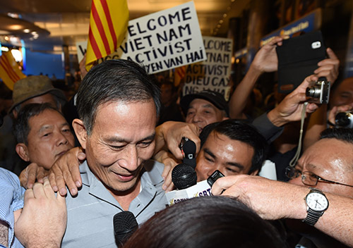 Vietnamese blogger Nguyen Van Hai arrives in Los Angeles in October 2014 after being released from jail and forced into exile. The U.S. says trade deals will depend on human rights but press freedom conditions remain poor in Vietnam. (AFP/Robyn Beck)